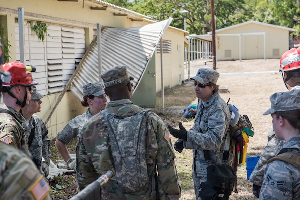 U.S. Airmen and Soldiers from the 3rd Chemical, Biological, Radiological, Nuclear Task Force, Pennsylvania National Guard, discuss aspects of their training scenario during the exercise Vigilant Guard, March 12, 2019, at Camp Santiago in Salinas, Puerto Rico. Members from the 3rd CBRN TF conducted wide-area search training, focusing on searching a large distance and going from building to building, marking and finding casualties.