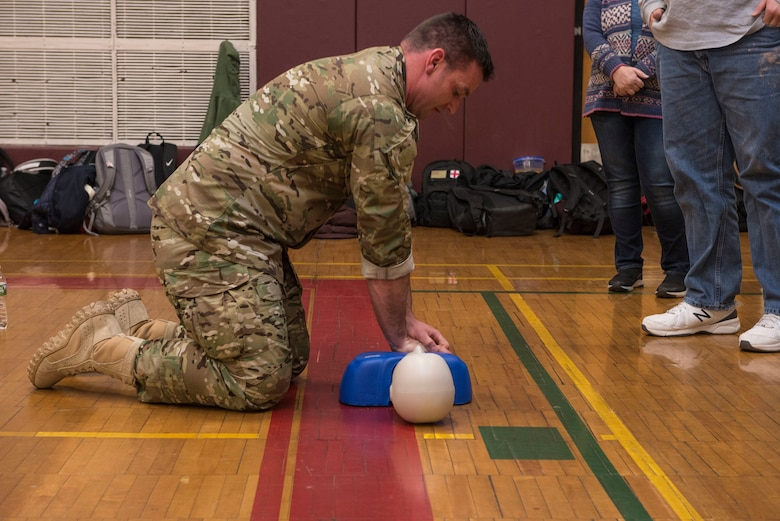 Master Sgt. Darrel Hanrahan, an Aerospace Medical Technician assigned to the 103rd Medical Group, demonstrates chest compressions on a CPR manikin during a CPR class at Torrington High School,  Torrington, Conn., March 22. Airmen from the 103rd Medical Group volunteered to help students meet requirements for their physical education class. (U.S. Air National Guard photo by Staff Sgt. Steven Tucker)