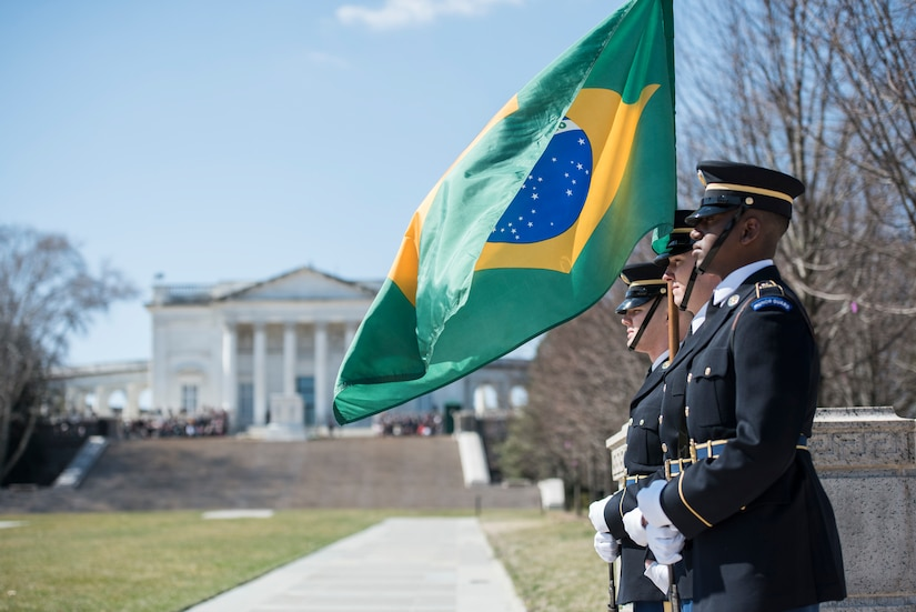 A color guard stands at attention.
