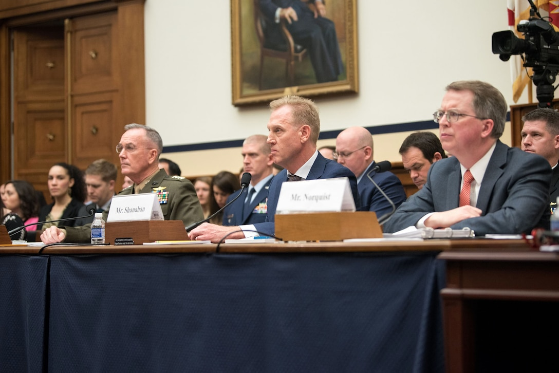 Acting Defense Secretary Patrick M. Shanahan, Marine Corps Gen. Joe Dunford and David L. Norquist sit at a table alongside each other.