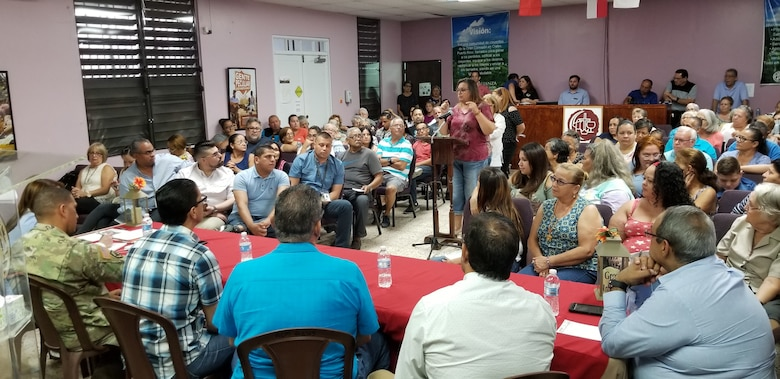 Photo of crowd addressing USACE personnel in Ciales, PR.