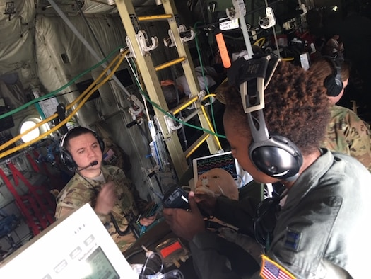 Capt. Thomas Ross, exercise trainer and an 81st Medical Group Critical Care Air Transport Team registered nurse (left) and Capt. Shartia Bowers, a CCATT registered nurse (right) work inside a C-130J Super Hercules aircraft during an exercise March 10, 2019, at Keesler Air Force Base, Miss., involving the Air Force Reseve Airmen of the 403rd Wing's 36th Aeromedical Evacuation Squadron and the 815th Airlift Squadron and active duty Air Force service members of the 81st MDG CCATT.  All three military units are at Keesler Air Force Base, Miss. (U.S. Air Force Photo by Lt. Col. Ryan Mihata).