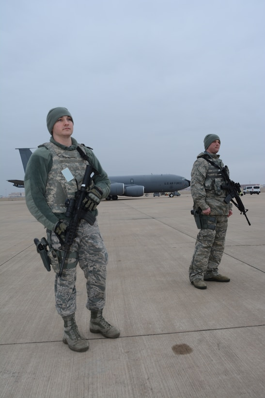Staff Sgt. Jeffrey Wright and Senior Airman Andrew Coughlin, 507th Security Forces Squadron, stand guard during an exercise geared toward wartime preparation and readiness March 2, 2019, at Tinker Air Force Base, Oklahoma. The 507th Air Refueling Wing's unit effectiveness inspection capstone event is scheduled for Nov. 15-19, 2019. (U.S. Air Force photo by Tech. Sgt. Lauren Gleason) (This photo has been altered for security purposes by blurring out identification badges.)