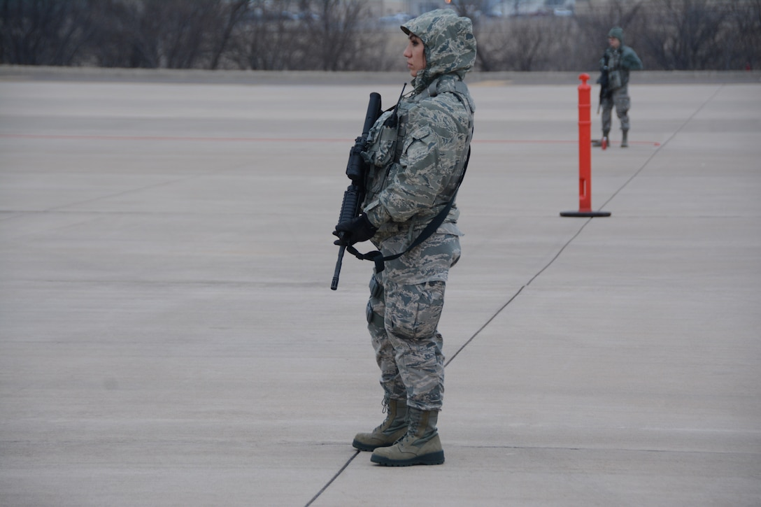 Senior Airman Yesenia Anguiano, 507th Security Forces Squadron, guards the perimeter of a secure area during an exercise geared toward wartime preparation and readiness on the 507th Air Refueling Wing flightline March 2, 2019, at Tinker Air Force Base, Oklahoma. The 507th Air Refueling Wing's unit effectiveness inspection capstone event is scheduled for Nov. 15-19, 2019. (U.S. Air Force photo by Tech. Sgt. Lauren Gleason)