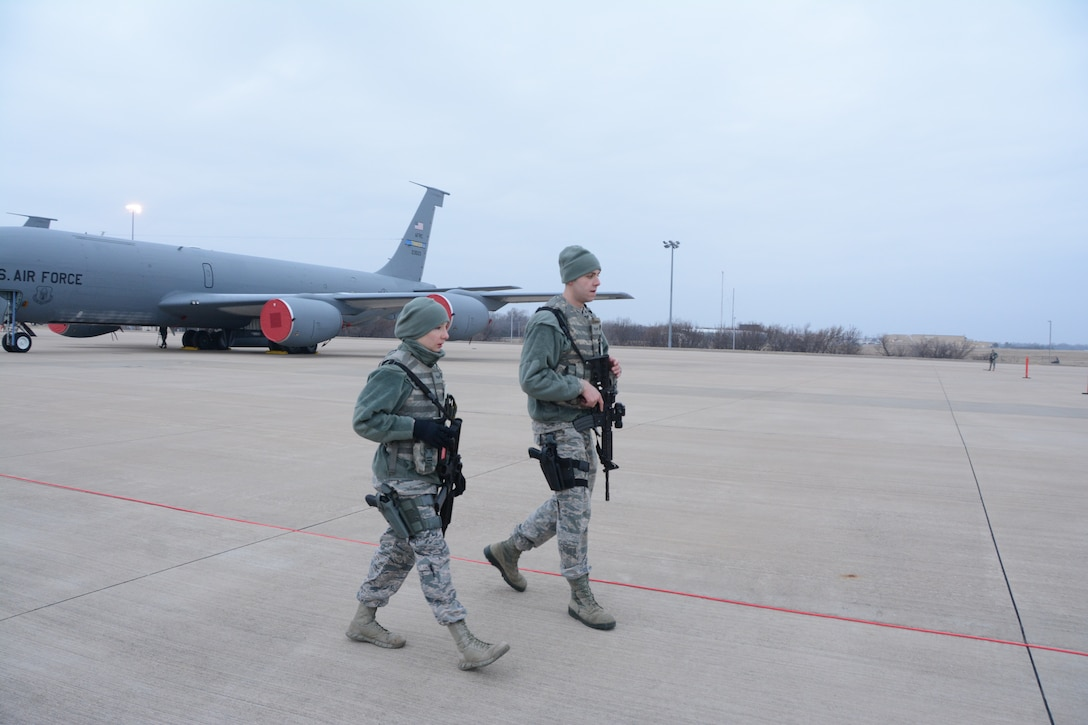 Senior Airmen Taylor Adamson and Austin Hiatt, 507th Security Forces Squadron, set up a secure perimeter during an exercise geared toward wartime preparation and readiness on the 507th Air Refueling Wing flightline March 2, 2019, at Tinker Air Force Base, Oklahoma. The 507th Air Refueling Wing's unit effectiveness inspection capstone event is scheduled for Nov. 15-19, 2019. (U.S. Air Force photo by Tech. Sgt. Lauren Gleason)