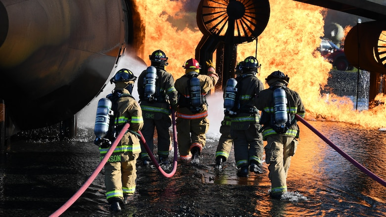 U.S. Air Force firefighters from the 2nd Civil Engineering Squadron and firefighters from the Shreveport Fire Department put out a simulated aircraft fire March 21, 2019, at Barksdale Air Force Base, Louisiana. The firefighters simulated spraying a foam blanket over the fire, to remove oxygen from the flames and put out the fire. (U.S. Air Force photo by Airman Jacob B. Wrightsman)