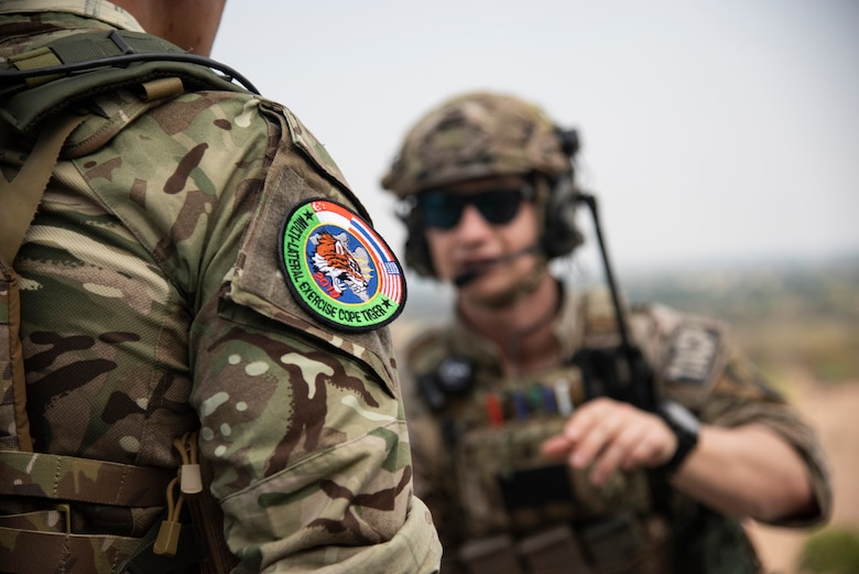 A COPE Tiger 19 patch is displayed on Royal Thai air force Flying Officer Jirot Prasoetampaisakul, 2nd Company 3rd Battalion Special Operations combat control team member, uniform during COPE Tiger 19 at Chandy Range, Thailand, March 15, 2019.