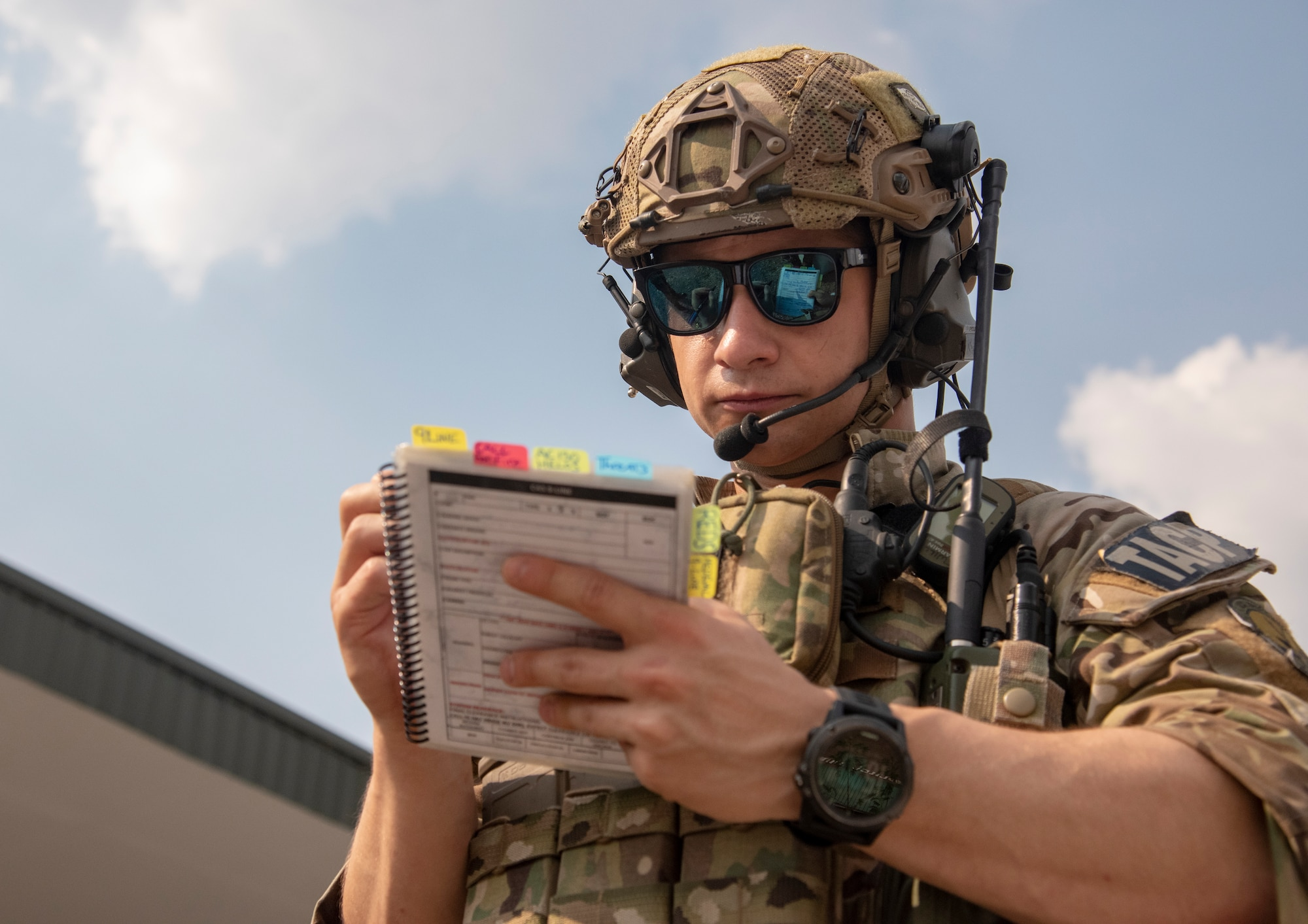 U.S. Air Force Staff Sgt. Tim Williams, tactical air control party joint terminal attack controller assigned to the 116th Air Support Operations Squadron, Washington Air National Guard, reviews tactics and procedures prior to calling in a simulated close air support attack during COPE Tiger 19 at Royal Thai Air Force Chandy Range, Thailand, March 15, 2019.