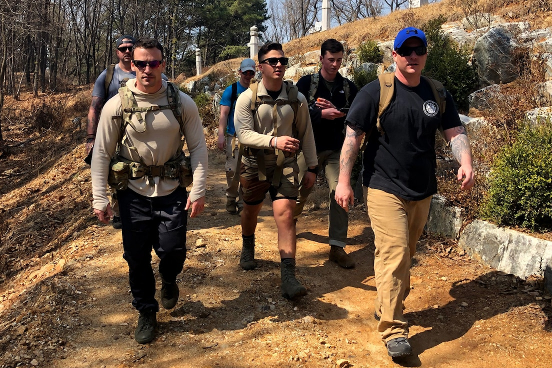 U.S. Air Force and U.S. Army explosive ordnance disposal members hike Mubong Mt. in Mubong, Republic of Korea, March 22, 2019. The members hiked a 3.5 mile trail, toured a temple and received history lessons on Buddhism. (U.S. Air Force photo by Staff Sgt. Sergio A. Gamboa)