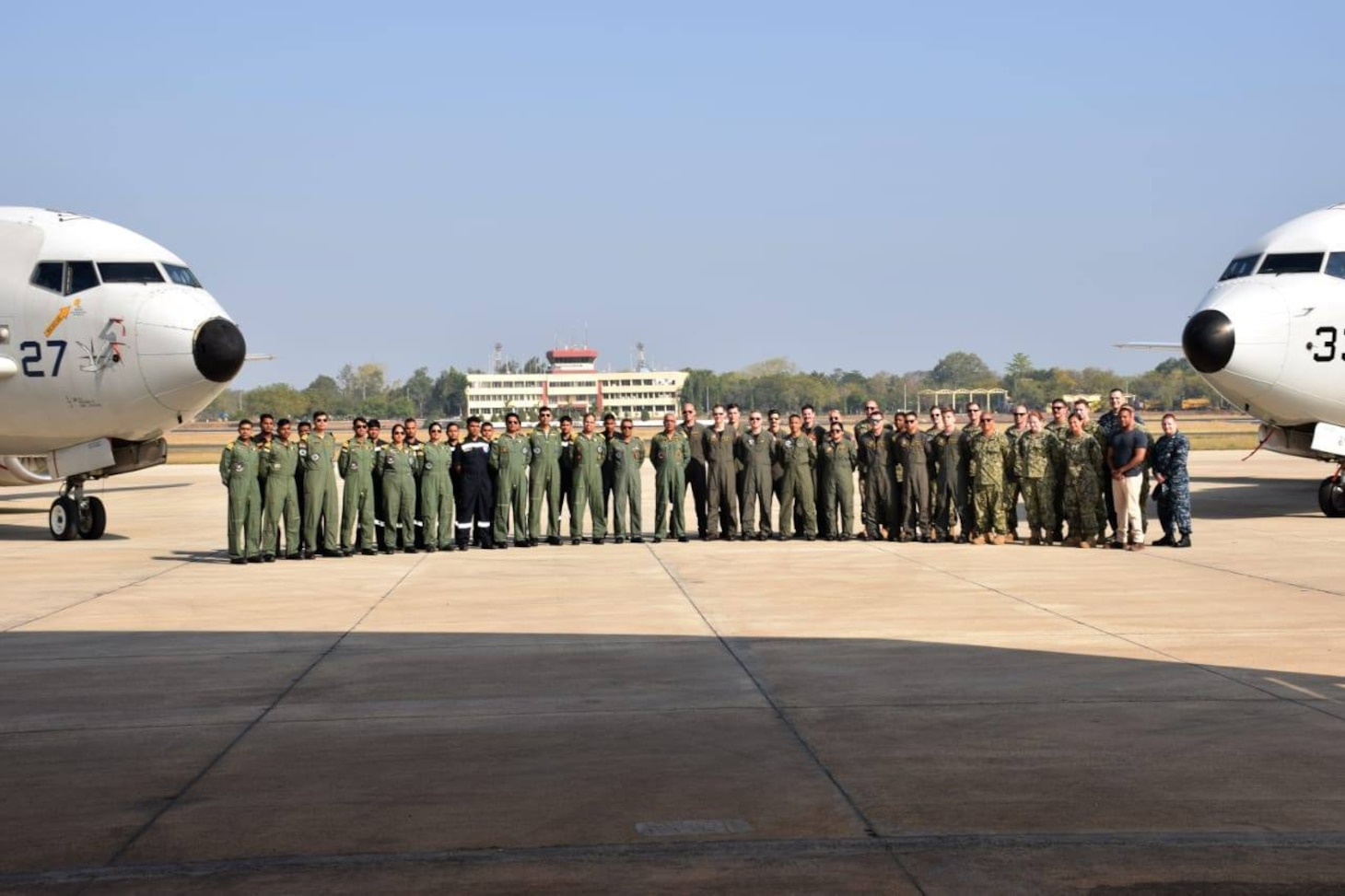 U.S. Navy Sailors pose for a group photo with Indian navy aircrews during a subject matter expert exchange.