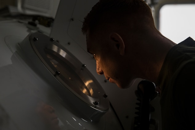 Petty Officer 1st Class Will Crampton, a first class navy diver with 3rd Reconnaissance Battalion, III Marine Expeditionary Force, monitors Marines inside a Standard Navy Double Lock Hyperbaric Recompression Chamber (SNDLRCS) at Camp Schwab, Okinawa, Japan, Jan. 9, 2019. Crampton observed the Marines to ensure their safety while in a SNDLRCS during a training scenario to simulate the pressure felt when diving up to 60 feet in order to enhance combat readiness. (U.S. Marine Corps photo by Lance Cpl. Hannah Hall/Released)