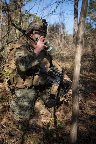 Sgt. Liam Lynch communicates during Tactical Recovery of Aircraft and Personnel training at Camp Lejeune, North Carolina, Feb. 1, 2019. TRAP training enhances combat readiness and crisis response skills by preparing Marines to confidently enter potentially combative areas, tactically extract personnel, recover aircraft, and retrieve or destroy sensitive material. Lynch is an Infantry Marine with 1st Battalion, 8th Marines. (U.S. Marine Corps photo by Lance Cpl. Larisa Chavez)