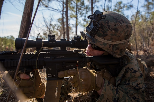Lance Cpl. Jacob Deryke  provides security during Tactical Recovery of Aircraft and Personnel training at Camp Lejeune, North Carolina, Feb. 1, 2019. TRAP training enhances combat readiness and crisis response skills by preparing Marines to confidently enter potentially combative areas, tactically extract personnel, recover aircraft, and retrieve or destroy sensitive material. Deryke is an Infantry Marine with 1st Battalion, 8th Marines, 24th Marine Expeditionary Unit. (U.S. Marine Corps photo by Lance Cpl. Larisa Chavez)