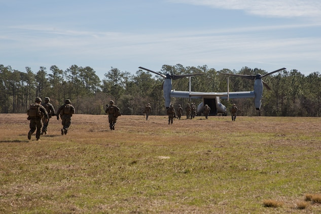 Marines board an MV-22 Osprey during Tactical Recovery of Aircraft and Personnel training at Camp Lejeune, North Carolina, Feb. 1, 2019. TRAP training enhances combat readiness and crisis response skills by preparing Marines to confidently enter potentially combative areas, tactically extract personnel, and recover aircraft, retrieve or destroy sensitive material. The Marines are with 1st Battalion, 8th Marines. (U.S. Marine Corps photo by Lance Cpl. Larisa Chavez)