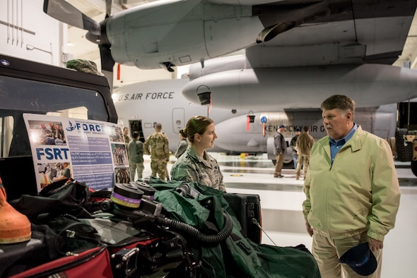 "Staff Sgt. Sara Hozian, 123rd Force Support Squadron Fatality Search and Recovery Team member, demonstrates the use of FSRT equipment to a civilian employer at the Kentucky Air National Guard Base in Louisville, Ky., March 15, 2019. The employers were participating in an Employer Support of the Guard and Reserve ""Bosslift,"" which enhances awareness and understanding between National Guardsmen and the civilian employers for whom they work when they're not on duty. (U.S. Air National Guard photo by Staff Sgt. Joshua Horton)"
