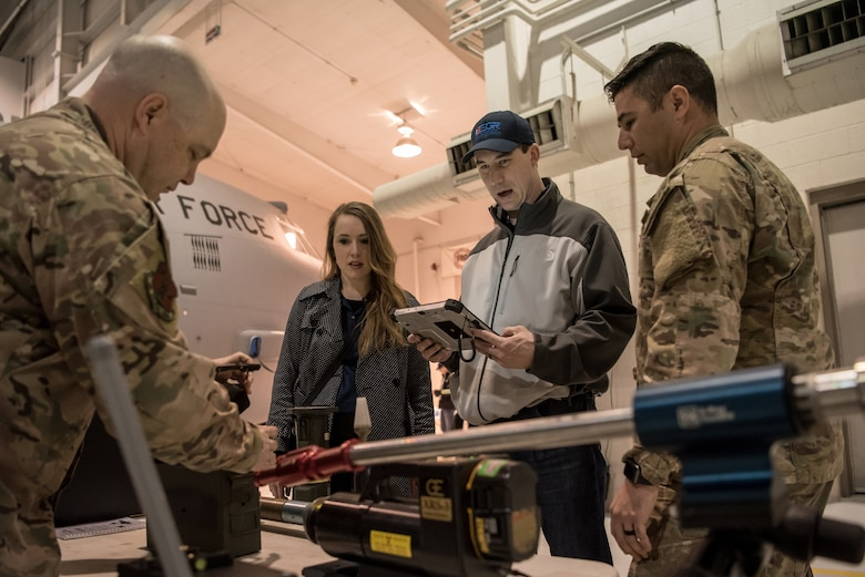 """Master Sgt. Matthew Wilt of the 123rd Explosive Ordnance Disposal Flight, demonstrates the use of EOD equipment to civilian employers at the Kentucky Air National Guard Base in Louisville, Ky., March 15, 2019. The employers were participating in an Employer Support of the Guard and Reserve """"Bosslift,"""" which enhances awareness and understanding between National Guardsmen and the civilian employers for whom they work when they're not on duty. (U.S. Air National Guard photo by Staff Sgt. Joshua Horton)"""