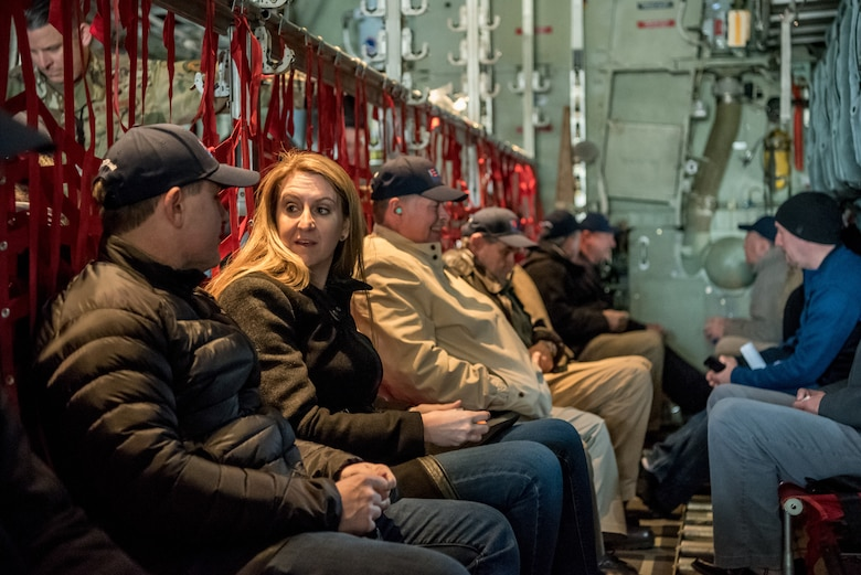 """More than two-dozen civilian employers fly to Wright Patterson Air Force Base, Ohio, aboard a Kentucky Air National Guard C-130 Hercules aircraft from Louisville, Ky., March 15, 2019. The flight, with Airmen from the 123rd Ailift Wing, was part of an Employer Support of the Guard and Reserve """"Bosslift,"""" which enhances awareness and understanding between National Guardsmen and the civilian employers for whom they work when they're not on duty. (U.S. Air National Guard photo by Staff Sgt. Joshua Horton)"""