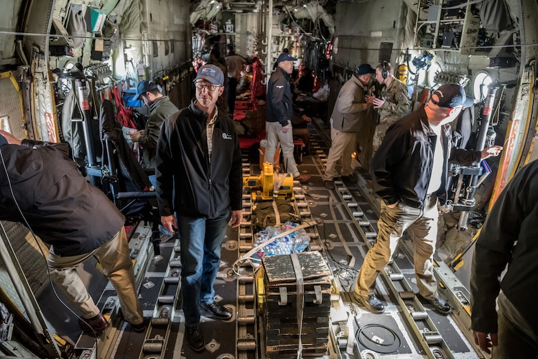 """More than two-dozen civilian employers travel on a Kentucky Air National Guard C-130 Hercules aircraft with Airmen from the 123rd Airlift Wing and representatives of the Kentucky Committee for Employer Support of the Guard and Reserve in the airspace above central Ohio, March 15, 2019. The employers were participating in an ESGR """"Bosslift,"""" which enhances awareness and understanding between National Guardsmen and the civilian employers for whom they work when they're not on duty. (U.S. Air National Guard photo by Staff Sgt. Joshua Horton)"""