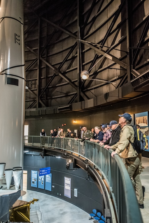"""More than two-dozen civilian employers tour the National Museum of the United States Air Force at Wright-Patterson Air Force Base, Ohio, March 15, 2019, with Airmen from the 123rd Airlift Wing and representatives of the Kentucky Committee for Employer Support of the Guard and Reserve. The employers were participating in an ESGR """"Bosslift,"""" which enhances awareness and understanding between National Guardsmen and the civilian employers for whom they work when they're not on duty. (U.S. Air National Guard photo by Staff Sgt. Joshua Horton)"""