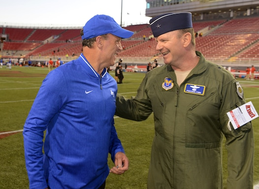 Brig. Gen. Christian Funk chats with Troy Calhoun, the Air Force Academy's head football coach. (Master Sgt. Chance Babin)