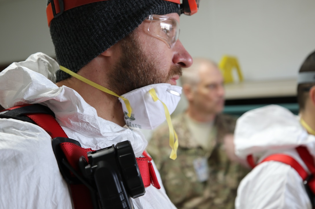 Keith Grezlik and Art Wolf, Environmental Response Team discuss the execution strategy for the safe entry of the crawl space. Huntsville Center provides support to the United States Forces-Afghanistan through a contract with AECOM's Environmental Response Team. The ERT's primary mission was to vent and provide fresh air to the confined space, and monitor the air quality during the assessment.