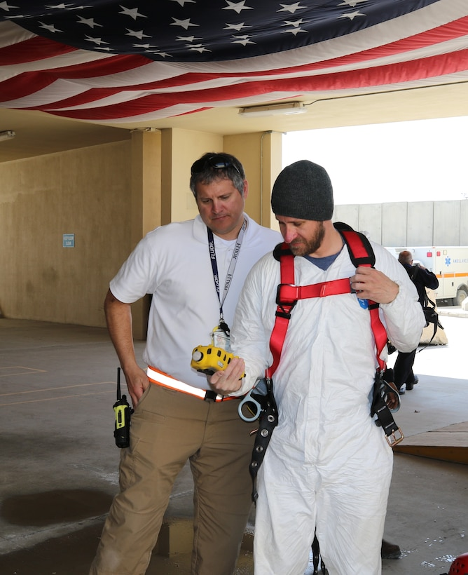 David Lynne, Area Support Group-Afghanistan and George Parker, Flour Fire Department discuss readings from a wireless portable multi-gas monitor. The Bagram Fire Department provided ongoing, continuous monitoring for combustion risk, oxygen concentration, carbon monoxide, and other hazardous gases, as well as emergency first response and extraction capability.