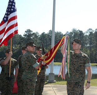 In most cases, the wind is not a friend of a flag bearer. However, Marine Corps Logistics Command's Color Guard stood at attention as the wind whipped the Marine Corps Colors and battle streamers in the air during a ceremony held at Covella Pond aboard Marine Corps Logistics Base Albany, March 21.  