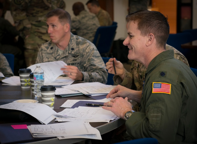 Lt. Col. Nicholas Rowe, 423rd Mobility Squadron commander, participates in an exercise scoring records of enlisted Airmen at Joint Base San Antonio-Randolph, Texas, March 19, 2019.