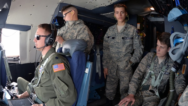 Civil Air Patrol cadets, Cadet Senior Airman Allen Doroshko, Cadet Airman Basic Caleb Wood, and Cadet Lt. Col. Jackson Baker, observe operations on the flight deck during an incentive flight over West Texas March 12. The cadets flew with the 433rd Airlift Wing at Joint Base San Antonio-Lackland.