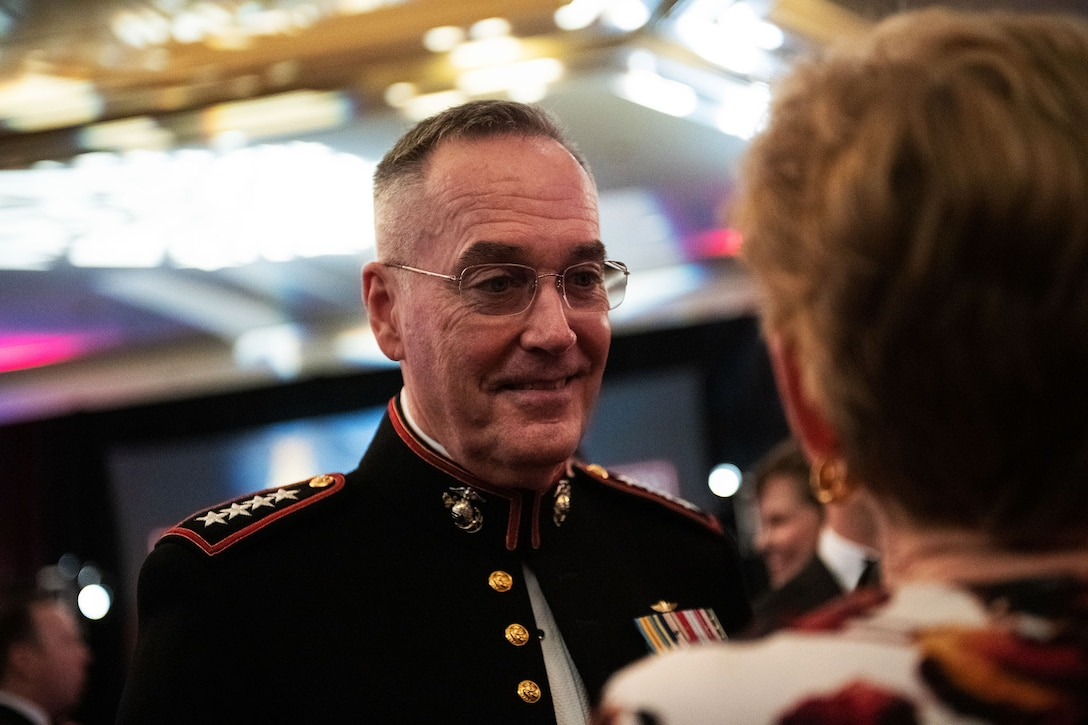 Marine Corps Gen. Joe Dunford, chairman of the Joint Chiefs of Staff, talks to his wife
