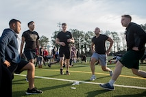 U.S. Marines and Sailors with 24th Marine Expeditionary Unit execute physical training at Camp Lejeune, N.C., Feb. 28, 2019. The training was held to promote unit cohesion and readiness. (U.S. Marine Corps photo by Lance Cpl. Larisa Chavez)