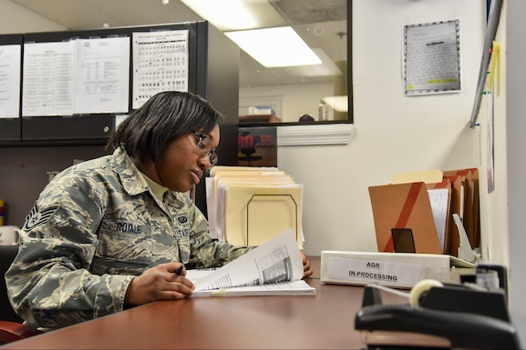 Staff Sgt. Lorena Royale, personnel specialist, Maryland Air National Guard, Joint Force Headquarters, collects mail for the personnel office, February 12, 2019, at the Fifth Regiment Armory, Baltimore, Maryland. Royale has been a member of the MDANG since 2014.