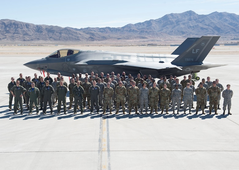 Members of the 62nd Fighter Squadron from Luke Air Force Base pose for a group photo March 9, 2019, at Nellis Air Force Base, Nev.  The team traveled to Nellis AFB to participate in Red Flag, exercise 19-2, and included Italian, Norwegian and U.S. personnel.