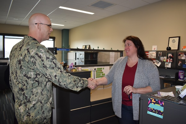 Distribution's Chrisman presented commander's coin