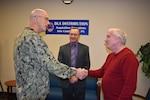 Distribution's Estes presented commander's coin