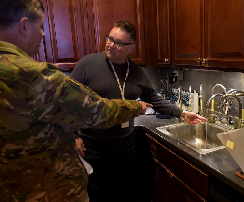 Robert Lauer, Pride Industries Water Treatment Plant assistant manager, shows the water plants in-house testing laboratory to U.S. Air Force Col. Neil R. Richardson, Joint Base McGuire-Dix-Lakehurst and 87th Air Base Wing commander, during a Water Production Plant tour March 26, 2019 at Joint Base MDL, New Jersey. Finished water is sampled in this area. (U.S. Air Force photo by Airman 1st Class Briana Cespedes)