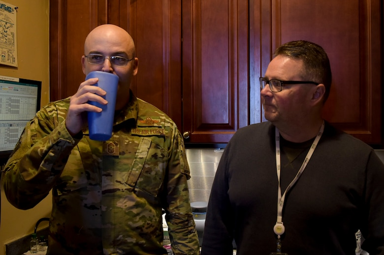 U.S. Air Force Chief Master Sgt. James Fitch, 87th Air Base Wing command chief, tastes freshly produced water during a Water Production Plant tour, March 26, 2019 at Joint Base McGuire-Dix-Lakehurst, New Jersey. Senior leadership received a tour from Robert Lauer (right), who is the Pride Industries Water Treatment Plant assistant manager. (U.S. Air Force photo by Airman 1st Class Briana Cespedes)
