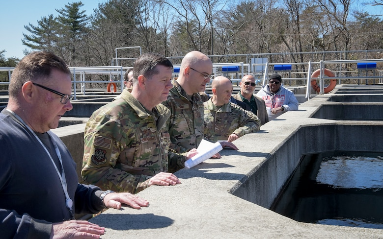 (Left) Robert Lauer, Pride Industries Water Treatment Plant assistant manager, observes the settling flocculation basins during a Water Production Plant tour, March 26, 2019 at Joint Base McGuire-Dix-Lakehurst, New Jersey. Lauer conducted a tour for U.S. Air Force Col. Neil R. Richardson, Joint Base MDL and 87th Air Base Wing commander, U.S. Air Force Chief Master Sgt. James Fitch, 87th ABW command chief, and U.S. Army Col. Daniel Grassetti, U.S Army Support Activity-Fort Dix deputy commander. (U.S. Air Force photo by Airman 1st Class Briana Cespedes)