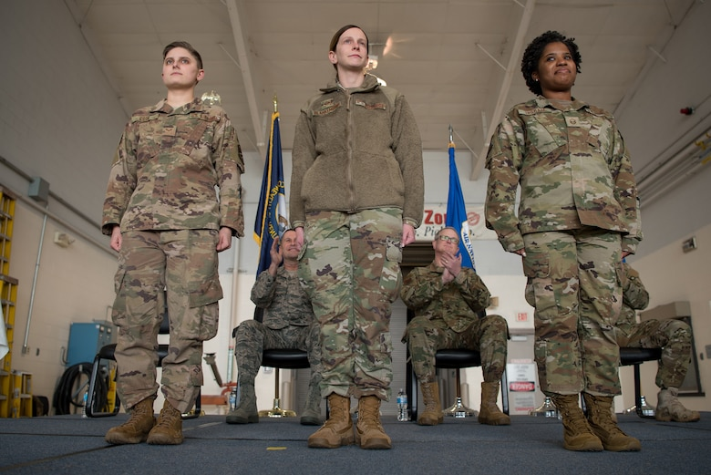 The Kentucky Air National Guard's Outstanding Airmen for 2018 — Senior Airman Brianna Cook (left), Staff Sgt. Danielle Blankenship (center) and Master Sgt. Brittany Ingram (right) — take the stage during a ceremony at the Kentucky Air National Guard Base in Louisville, Ky., March 10, 2019. The ceremony, which highlighted the unit's accomplishments during the past year, concluded with the presentation of the wing's 18th Air Force Outstanding Unit Award. (U.S. Air National Guard photo by Staff Sgt. Joshua Horton)