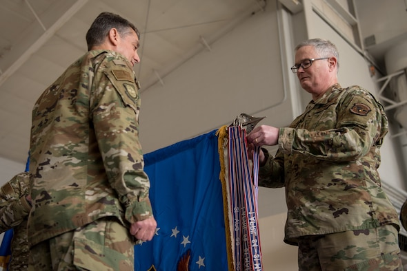 Col. David Mounkes (right), commander of the 123rd Airlift Wing, pins a streamer to the unit colors during a ceremony at the Kentucky Air National Guard Base in Louisville, Ky., March 10, 2019. The streamer signifies the unit's selection for its 18th Air Force Outstanding Unit Award, continuing its legacy as one of the most decorated organizations in U.S. Air Force History. (U.S. Air National Guard photo by Staff Sgt. Joshua Horton)
