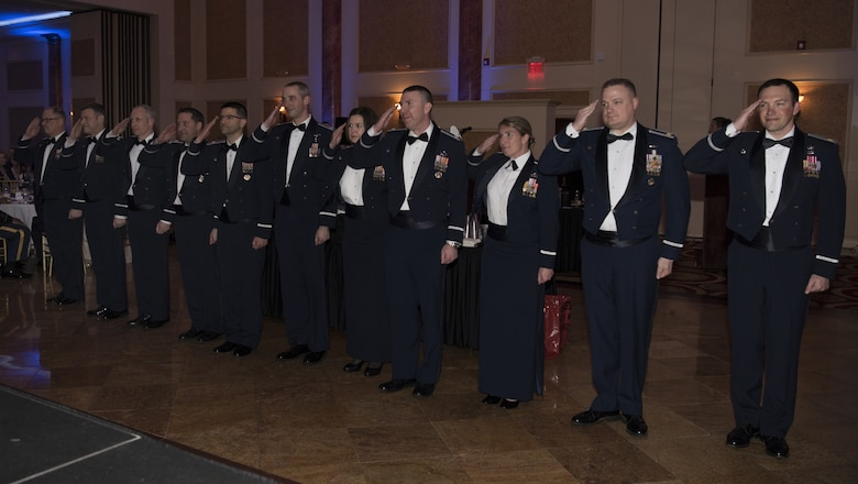 Wing commanders from Joint Base McGuire-Dix-Lakehurst Air Force units salute the 87th Air Base Wing commander during the 87th ABW Dining Out celebration at The Merion event center in Cinnaminson, N.J., March 22, 2019. The ballroom was filled with service members of various ranks celebrating the accomplishments that have been made within the wing in the last ten years. (U.S. Air Force photo by Airman 1st Class Ariel Owings)