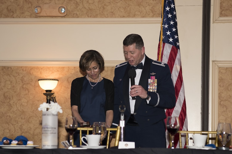 U.S. Air Force Col. Neil R. Richardson, Joint Base McGuire-Dix-Lakehurst and 87th Air Base Wing commander, presents an award to U.S. Air Force retired Lt. Gen. Gina Grosso during the 87th ABW Out celebration at The Merion event center in Cinnaminson, N.J., March 22, 2019. Grosso became the first commander of Joint Base MDL in 2009 as a colonel. Due to the inactivation of the 87th Troop Carrier Wing in 1952, Grosso was given the responsibility of rebuilding the wing into what is now – the 87th ABW. (U.S. Air Force photo by Airman 1st Class Ariel Owings)