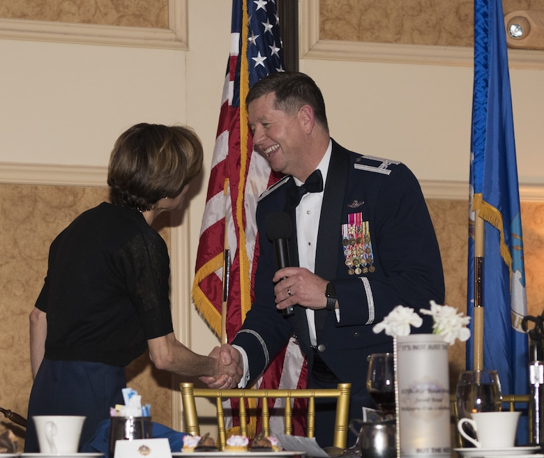 U.S. Air Force Col. Neil R. Richardson, Joint Base McGuire-Dix-Lakehurst and 87th Air Base Wing commander, shakes U.S. Air Force retired Lt. Gen. Gina Grosso's hand during the 87th ABW Dining Out celebration at The Merion event center in Cinnaminson, N.J., March 22, 2019. Grosso spoke of the impressiveness from members of the ten-year-old wing earning six Air Force Outstanding Unit Awards while some older units have never once received the award and challenged the residing Airmen to build on the success in future endeavors. (U.S. Air Force photo by Airman 1st Class Ariel Owings)