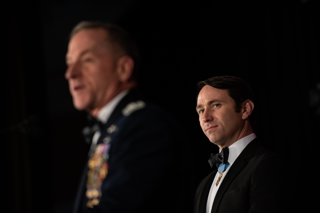 Soft focus on general in foreground introducing Medal of Honor recipient in background
