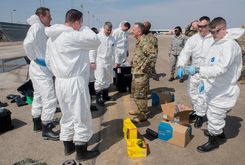 Air Force Chief of Staff Gen. David L. Goldfein talks with Airmen during his visit to Offutt Air Force Base, Nebraska, March 27, 2019. Goldfein and Chief Master Sgt. of the Air Force Kaleth O. Wright stopped by the installation to survey damage caused by recent flooding. (U.S. Air Force photo by Delanie Stafford)