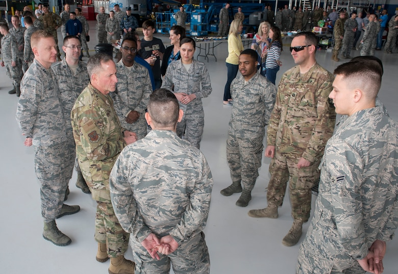 Air Force Chief of Staff Gen. David L. Goldfein talks with Airmen during his visit to Offutt Air Force Base, Nebraska, March 27, 2019. Goldfein was joined by Chief Master Sgt. of the Air Force Kaleth O. Wright to survey damage caused by recent flooding. (U.S. Air Force photo by Delanie Stafford)