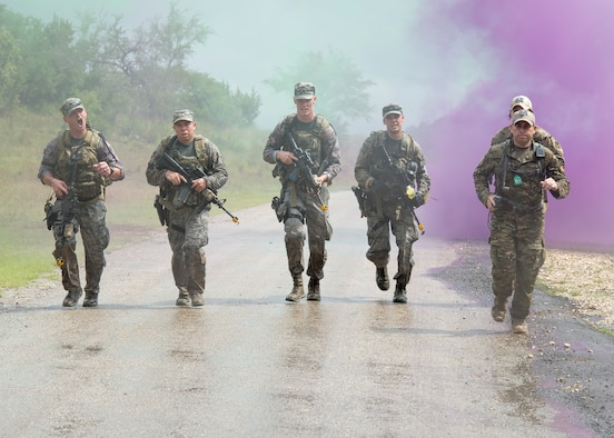 Airmen from the Air National Guard Air Force Defender's Challenge Team 2018 run to the finish line of the dismounted operations portion of the competition at Camp Bullis, San Antonio, Texas, on Sept. 12, 2018