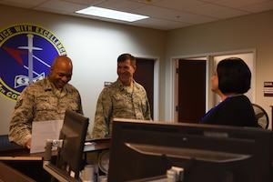 Tech. Sgt. Aubery Daniels, 14th Flying Training Wing Chapel NCO in charge of readiness and resources, and Chaplain (Maj.) Bradley Kimble, 14th FTW deputy chaplain, talk with Lorena Brady, 14th Comptroller Squadron unit program coordinator, March 25, 2019, on Columbus Air Force Base, Mississippi. The chapel team makes sure to talk and get to know Airmen from every shop on base through programs, events and walk-throughs. (U.S. Air Force photo by Senior Airman Beaux Hebert)