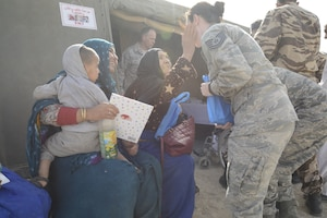 U.S. Air Force Tech. Sgt. Kelsey Roney, a logistics technician with the Utah Air National Guard greets patients during the humanitarian civic assistance component of exercise African Lion 2019 in Tata, Morocco, March 25, 2019. Exercise African Lion 2019 is a Chairman of the Joint Chiefs of Staff-sponsored, U.S. African Command-scheduled, U.S. Marine Corps Forces Europe and Africa-led, joint and combined exercise conducted in the Kingdom of Morocco. African Lion offers an opportunity for participation in a multinational exercise to enhance our professional relationships and allow support for interoperability of forces. (U.S. Air Force photo by Maj. Janine Smith)