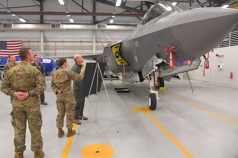 Gen. Mike Holmes, commander of Air Combat Command, is briefed about the status of the wing by Capt. Dayna Grant, 388th Aircraft Maintenance Squadron, during a visit to the 388th Fighter Wing March 26, 2019, at Hill Air Force Base, Utah. (U.S. Air Force photo by Todd Cromar)